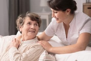 Nurse helping a senior