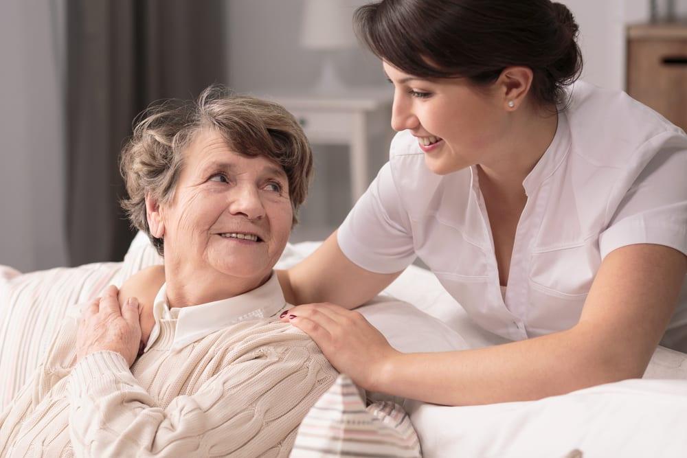 Nurse helping a senior