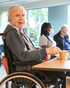lynn valley care centre, care home, senior in wheelchair smiling