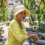 10 symptoms of dehydration in seniors, woman in the sun with a brimmed hat